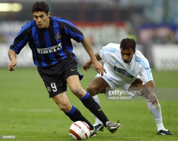 Inter Milan's Julio Ricardo Cruz challenges Olympic de Marseille's Habib Beye during their Uefa cup quarterfinals second leg match at Milan's San...