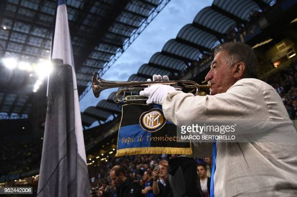 "Inter Milan's long-time supporter Giuseppe Ricciardi, known as ""Bepi il Trombetta"", plays trumpet during the Italian Serie A football match Inter..."