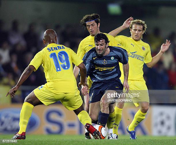 Inter Milan's Luis Figo comes up against Villarreal's Marcos Senna after beating Diego Forlan and Alessio Tacchinardi during their Champions league...