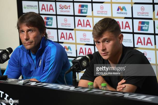 Inter Milan's manager Antonio Conte and player Nicolo Barella attend a press conference in Singapore on July 19 ahead of the team's International...