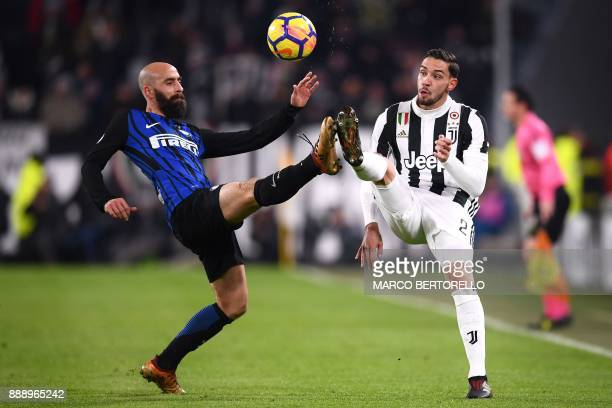 TOPSHOT Inter Milan's midfielder Borja Valero from Spain fights for the ball with Juventus' defender Mattia De Sciglio during the Italian Serie A...