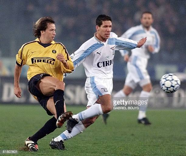 Inter Milan's midfielder French Benoit Cauet fights for the ball with Lazio Rome's midfielder Argentinian Diego Simeone during the Italian...