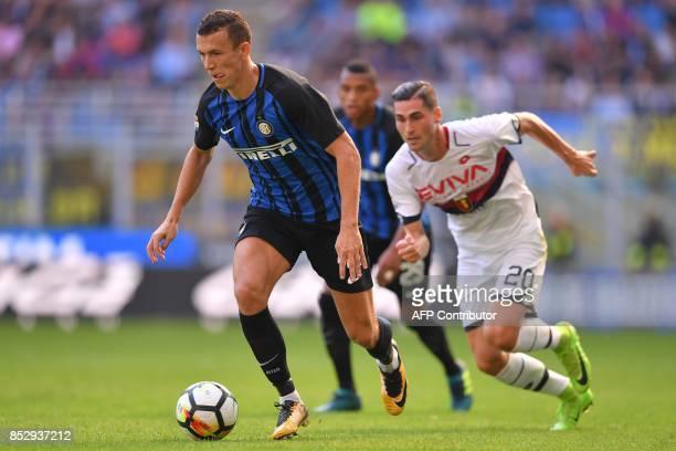 Inter Milan's midfielder from Croatia Ivan Perisic outruns Genoa's defender Aleandro Rosi during the Italian Serie A football match Inter Milan vs...