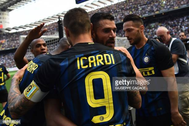 Inter Milan's midfielder from Italy Antonio Candreva celebrates with Inter Milan's forward from Argentina Mauro Icardi after scoring during the...