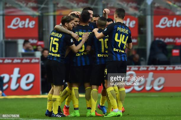 Inter Milan's midfielder from Italy Roberto Gagliardini celebrates with teammates after scoring a goal during the Italian Serie A football match...
