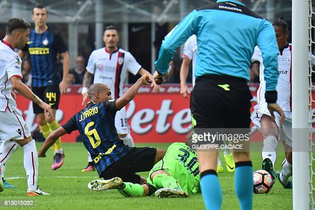 Inter Milan's midfielder from Portugal Joao Mario kicks and scores during the Italian Serie A football match Inter Milan vs Cagliari at 'San Siro'...