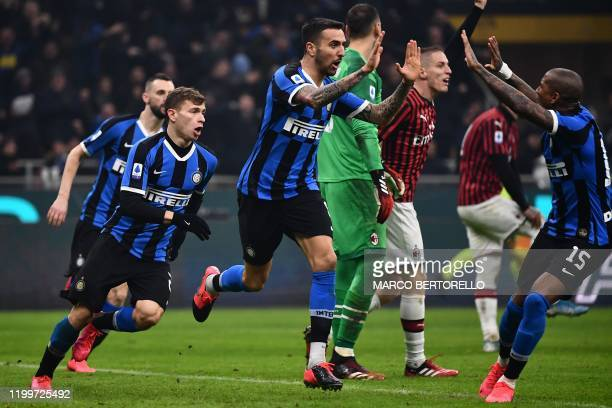 Inter Milan's midfielder Matias Vecino from Uruguay celebrates after scoring with his teammate during the Italian Serie A football match Inter Milan...