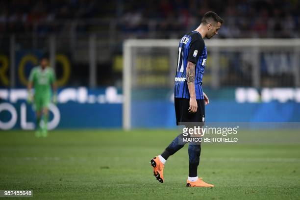 Inter Milan's midfielder Matias Vecino from Uruguay leaves the pitch after he received a red card during the Italian Serie A football match Inter...