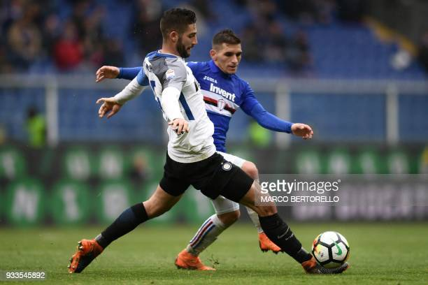 Inter Milan's midfielder Roberto Gagliardini from Italy fights for the ball with Sampdoria's midfielder Lucas Torreira of Uruguay during the Italian...