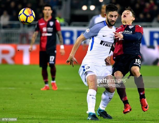 Inter Milan's midfielder Roberto Gagliardini vies for the ball with Cagliari's midfielder Nicolo Barella during the Italian Serie A football match...