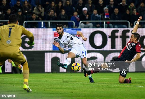 Inter Milan's midfielder Roberto Gagliardini vies for the ball with Cagliari's defender Simone Padoin during the Italian Serie A football match...