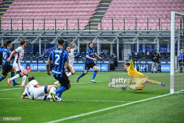 Inter Milan's Moroccan defender Achraf Hakimi centres the ball for Inter Milan's Italian defender Matteo Darmian to score the opening goal during the...
