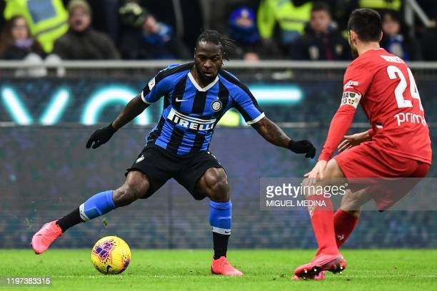 Inter Milan's Niferian midfielder Victor Moses challenges Fiorentina's Italian midfielder Marco Benassi during the Italian Cup round of 8 football...