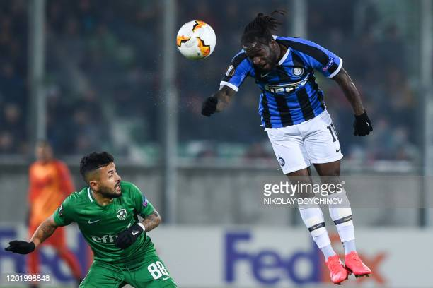Inter Milan's Niferian midfielder Victor Moses jumps for the ball in front of Ludogorets Razgrad's Bulgarian forward Wanderson during the UEFA Europa...