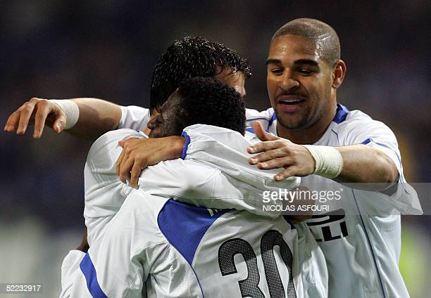 Inter Milan's Obafemi Martins celebrates his goal with teamates Dejan Stankovic and Adriano during the Champions league football match First knockout...