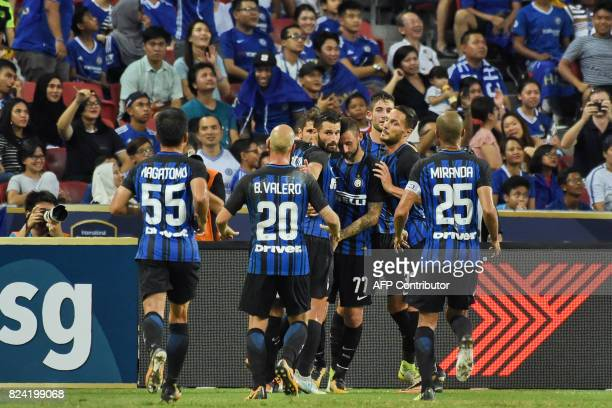 Inter Milan's players celebrate after teammate Stevan Jovetic scored against Chelsea during their International Champions Cup football match in...