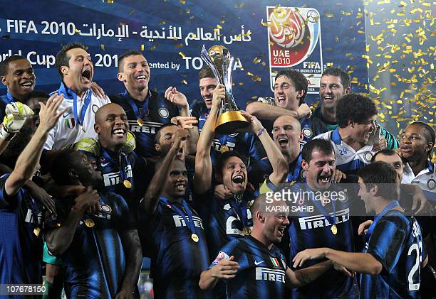 Inter Milan's players celebrate with the trophy after beating TP Mazembe in their 2010 FIFA Club World Cup final football match at Zayed Sports City...