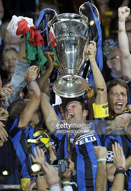 Inter Milan's players celebrate with the trophy after winning the UEFA Champions League final football match Inter Milan against Bayern Munich at the...