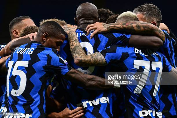 Inter Milan's players unite after Fiorentina scored an own goal during the Italian Serie A football match Inter vs Fiorentina on September 26, 2020...