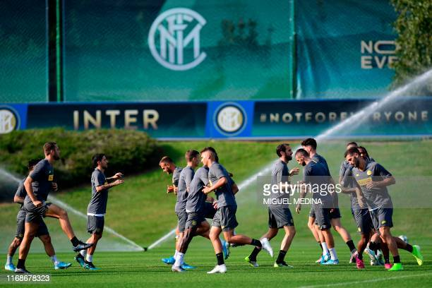 Inter Milan's players warm up during a training session at the training ground of Appiano Gentile, north of Milan on September 16, 2019 on the eve of...