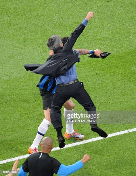 Inter Milan's Portuguese coach Jose Mourinho and Inter Milan's defender Marco Materazzi celebrate after winning the UEFA Champions League final...