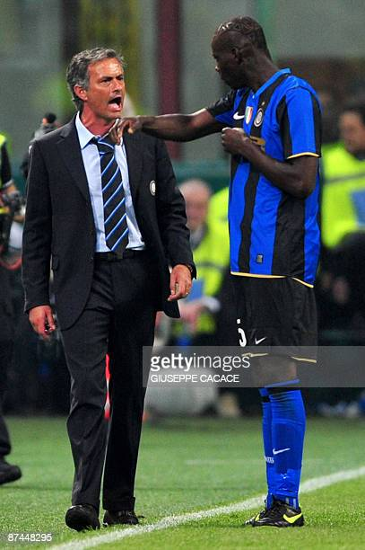 Inter Milan's Portuguese coach Jose Mourinho argues with Inter Milan's forward Mario Balotelli after he scored during their Serie A football match...