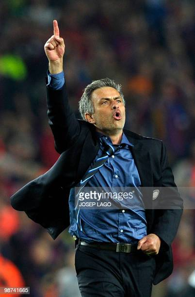 Inter Milan's Portuguese coach Jose Mourinho jubilates after winning the UEFA Champions League semifinal second leg football match Barcelona vs Inter...