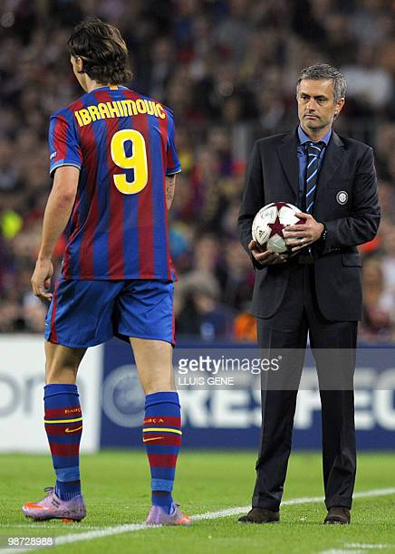 Inter Milan's Portuguese coach Jose Mourinho looks at Barcelona's Swedish forward Zlatan Ibrahimovic during the UEFA Champions League semifinal...
