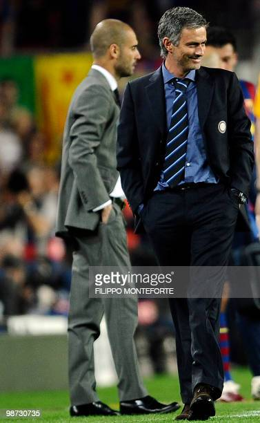 Inter Milan's Portuguese coach Jose Mourinho smiles next to Barcelona's coach Josep Guardiola during the UEFA Champions League semifinal second leg...