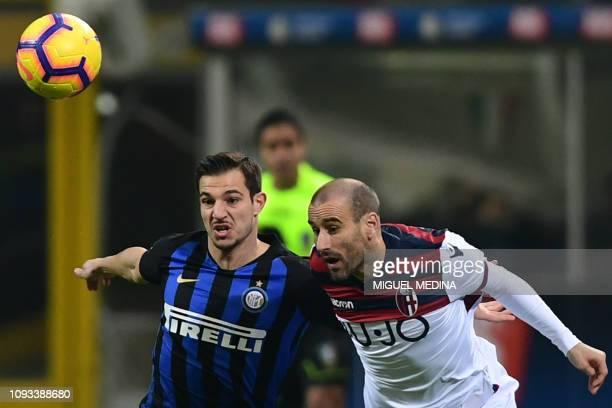 Inter Milan's Portuguese defender Cedric Soares and Bologna's Argentine forward Rodrigo Palacio go for the ball during the Italian Serie A football...