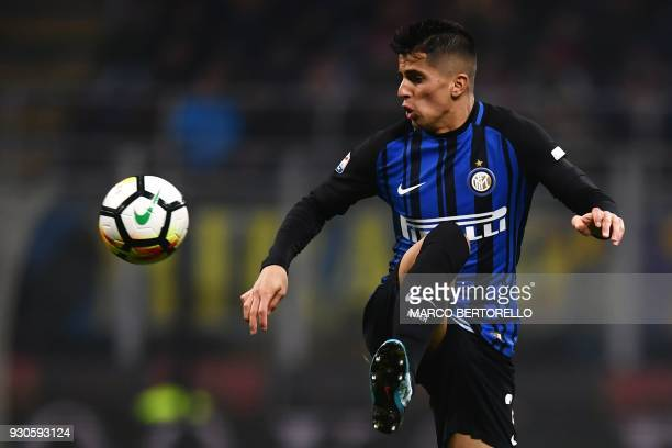 Inter Milan's Portuguese defender Joao Cancelo controls the ball during the Italian Serie A football match Inter Milan vs Napoli on March 11, 2018 at...