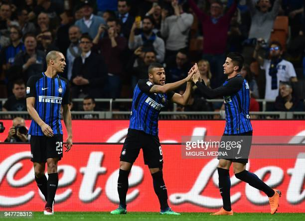 Inter Milan's Portuguese forward Joao Cancelo is congratulated by teammate Brazilian midfielder Rafinha after scoring during the Italian Serie A...