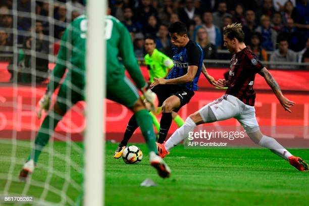 Inter Milan's Portuguese forward Joao Cancelo vies with AC Milan's Argentinian midfielder Lucas Biglia during the Italian Serie A football match...