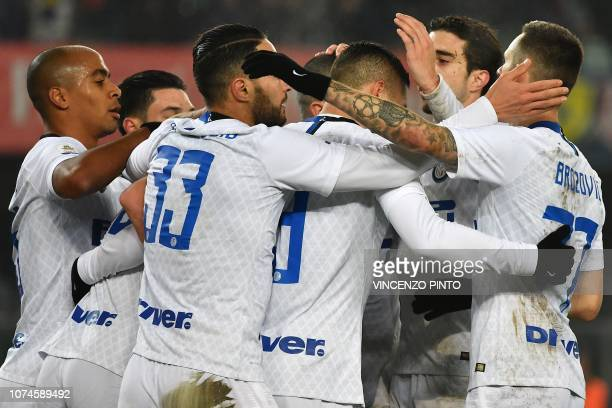Inter Milan's Portuguese midfielder Joao Mario celebrates with teammates after Inter opened the scoring during the Italian Serie A Football match...