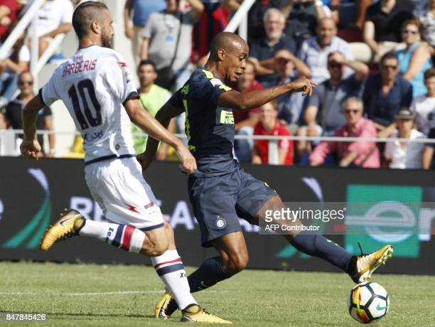Inter Milan's Portuguese midfielder Joao Mario fights for the ball with Crotone's Italian midfielder Andrea Barberis during the Italian Serie A...
