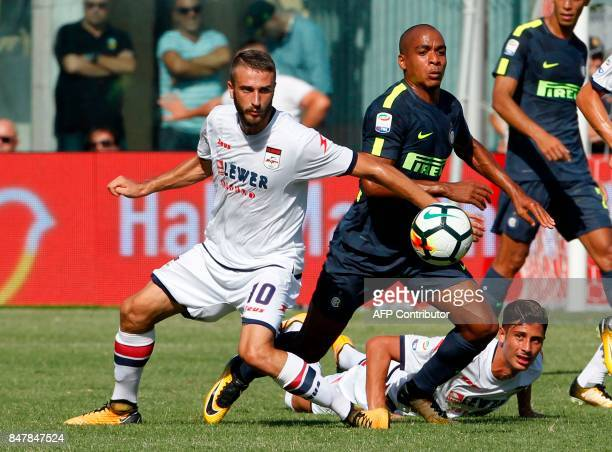 Inter Milan's Portuguese midfielder Joao Mario fights for the ball with Crotone's Italian midfielder Andrea Barberis as Crotone's Italian midfielder...