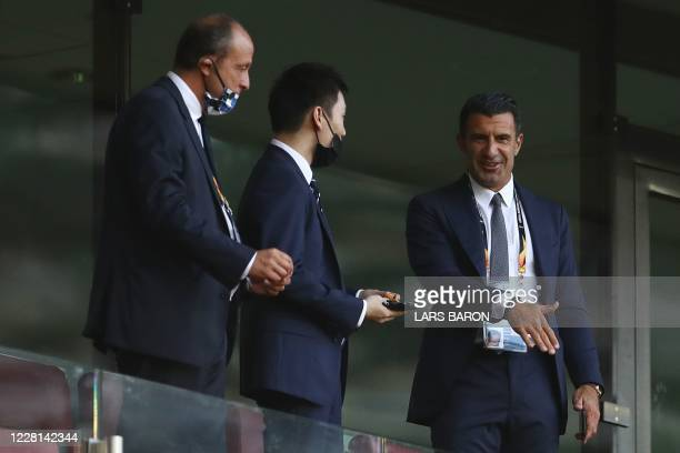 Inter Milan's President, Chinese businessman Steven Zhang speaks in the tribunes with former Portuguese international Luis Figo prior to the UEFA...