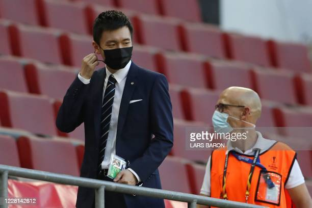 Inter Milan's President, Chinese businessman Steven Zhang stands in the tribunes wearing a face mask prior to the UEFA Europa League final football...