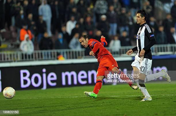 Inter Milan's Rodrigo Palacio shoots the ball past Partizan Belgrade's Milos Ostojic during the UEFA Europa League group H football match Partizan...