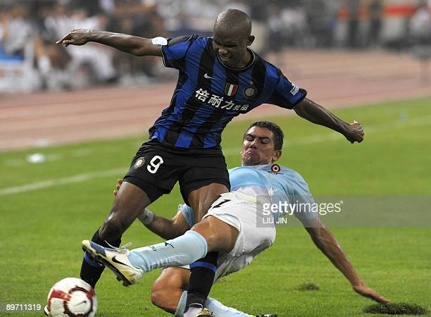 Inter Milan's Samuel Eto'o Fils vies with Lazio's Stefano Mauri during the Italian Super Cup match at the National Stadium, also known as the Bird's...