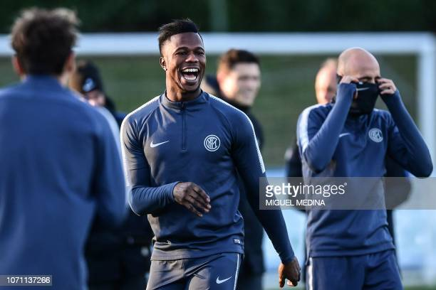 Inter Milan's Senegalese forward Keita Balde jokes during a training session on the eve of the UEFA Champions League group B football match Inter...