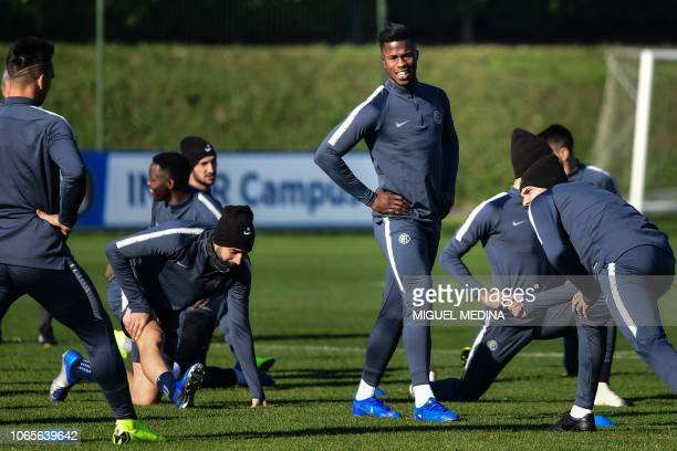 Inter Milan's Senegalese forward Keita Balde stretches during a training session at the Appiano Gentile training ground on November 27 on the eve of...