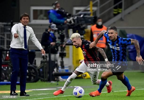 Inter Milan's Serbian defender Aleksandar Kolarov fights for the ball with AC Milan's Spanish forward Samuel Castillejo during the Italian Serie A...