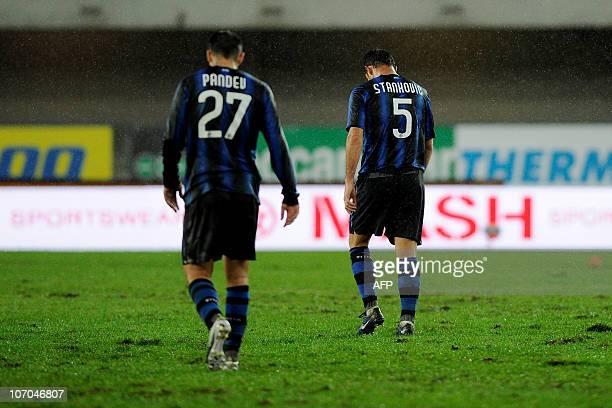 Inter Milan's Serbian midfielder Dejan Stankovic and Inter Milan's Macedonian forward Goran Pandev react after conceding their 2nd goal to Chievo...