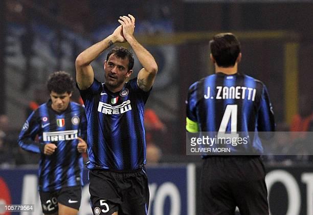 Inter Milan's Serbian midfielder Dejan Stankovic celebrates after scoring a penalty against Tottenham during their UEFA Champions League football...