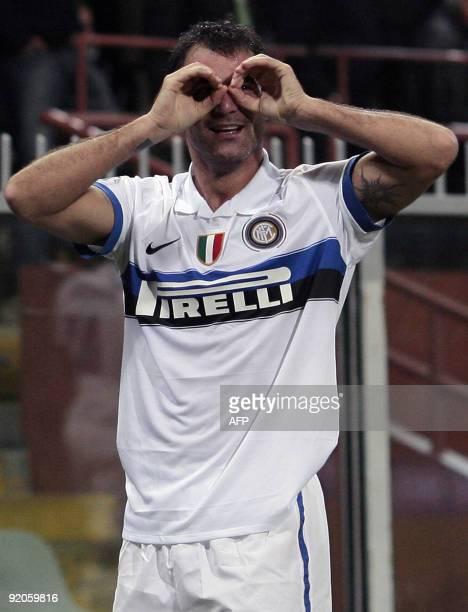 Inter Milan's Serbian midfielder Dejan Stankovic celebrates after scoring a goal against Genoa during their Serie A football match at Ferraris...