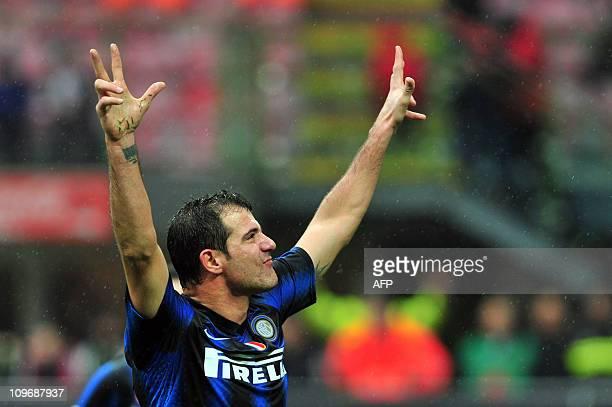 Inter Milan's Serbian midfielder Dejan Stankovic celebrates after scoring during the Serie A football match between Inter Milan and Parma at San Siro...