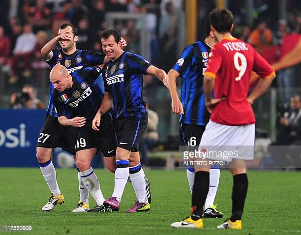Inter Milan's Serbian midfielder Dejan Stankovic celebrates after scoring with teamates Inter Milan's Dutch midfielder Wesley Sneijder and Inter...