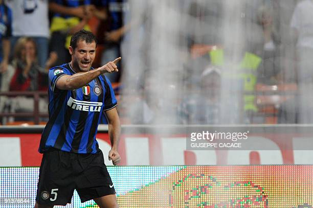 Inter Milan's Serbian midfielder Dejan Stankovic celebrates after scoring during their Serie A football match Inter Milan vs Udinese at San Siro...
