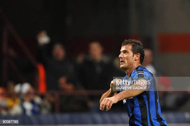 Inter Milan's Serbian midfielder Dejan Stankovic celebrates after scoring against ynamo Kiev during their UEFA Champions League group stage football...